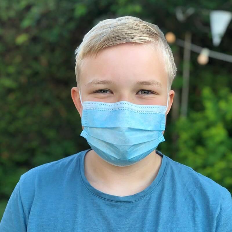 Barn 12 år med mundbind