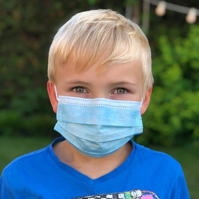 Barn 7 år med mundbind